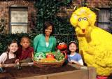 First Lady Michelle Obama on the PBS show Sesame Street, talking about healthy eating. Sesame Street was originally conceived to help give kids from disadvantaged backgrounds the same preparation for Kindergarten that more affluent kids got.